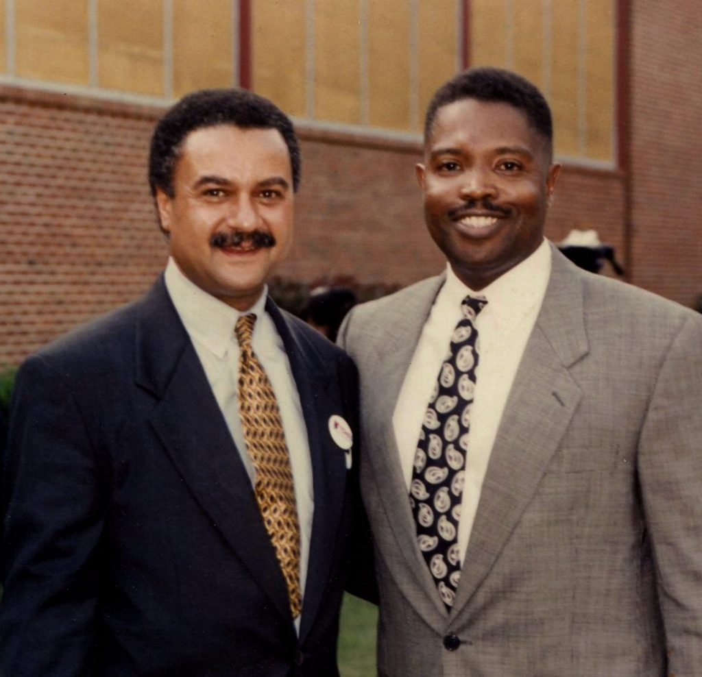 Photograph of James Ewers on the Right with Ron Brown on the Left, first African American to serve as the U. S. Secretary of Commerce