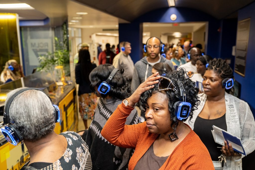 RCLM37 Exhibit Visitors With Wireless Headphones